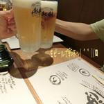 55876756 - 生ビール(620円)で乾杯〜( ^ ^ )/□                       お通しはキャベツの塩もみ☆彡