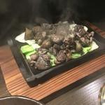 55883520 - 混ぜ焼き 熱々の鉄板に乗ってきました。柚子胡椒で頂きました。キャベツも美味しい