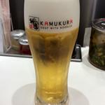 どうとんぼり神座 - 一杯目のビール(税込300円)。