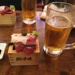 56179295 - お通しの刺身とヱビス生ビール