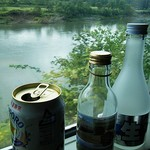 56304539 - 北の大河。天塩川を眺めながら。。。(酒がススむな~)