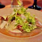 56419582 - ネルベッティのサラダ ブルーベリーソース アキレス腱の煮こごり