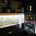 56461317 - 店頭のディスプレイと看板が素敵。