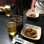 ずぼら - 大瓶ビール550円