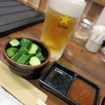 56562743 - 生ビール_550円、きゅうりの漬物_400円、焼肉のタレ
