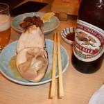 56614439 - ハマグリと瓶ビール