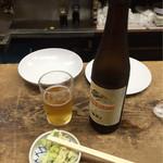 56814763 - 【ビール小】(350円税込)とお通し。