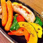 沖縄食堂 瀬戸海人 - アグー豚の手作りソーセージ。肉汁ジュワッと旨味が凝縮