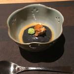 57336074 - 黒ごま豆腐の味噌ソース和え⁈ ウニのせ(お通し)
