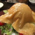 57425900 - 春巻きの皮の帽子をかぶったシーザーサラダ                       チーズはテーブルで掛けてくれます。