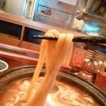 57446408 - 硬さは普通のうどんと同じストレート平麺。