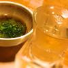 Megumisuisan - 料理写真:辛口の日本酒と、お通しのめかぶ
