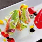 DINING 蔵RA - スペイン産ハモンセラーノとクリームチーズの生春巻~フランボワーズのソースで~
