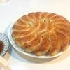 焼肉・円盤餃子 ひたち - 料理写真:カリカリ円盤餃子