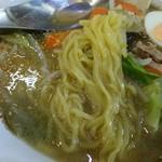 58114897 - 結構黄色みの強い中華麺