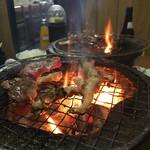 龍巳ホルモン - 料理写真:煙モクモク