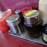 58656995 - 「一久 西岐波店」卓上のコショウ・ラー油・ギョーザのタレ・ソース・紅ショウガ