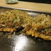 めんひち - 料理写真:お好み焼きデラックス(←)と豚玉(→)
