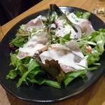 カリメロ - 生ハムと温玉のシーザーサラダ 920円