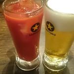 博多満月 - トマトジュース(300円)生ビール(199円)
