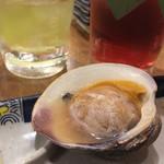 磯丸水産 - 蛤の殻焼