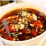 59448274 - 魚の四川火鍋煮込み(4000円コース料理) スープは飲むものじゃないです。