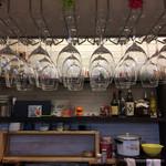 59715317 - 2016.12.6                       カウンターの食事席から店内に吊っているワイングラスを撮影しました
