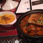 59775835 - フィッシュタジンは、タジン鍋を使って魚と野菜をトマトベースで煮込んだ料理。クスクスを添えて頂きます。
