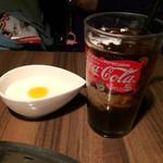 牛吟 - アイスコーヒー/¥100と杏仁豆腐(マンゴーソース)