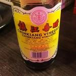 60318539 - 黒酢(お好みで味を変えて楽しめます)