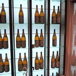 海鮮個室居酒屋 とらや - ズラリと並ぶ金宮焼酎の一升瓶