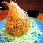 居酒屋まるまん - 京芋コロッケ。