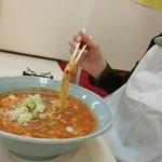 カレータンタン麺 花虎 - 紙エプロンあります