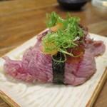 立ち寿司 まぐろ一徹 - ほほ肉炙り
