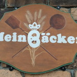 マインベッカー - 店前の看板
