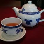 61323443 - プーアル茶。ポットとお茶碗可愛いですね。