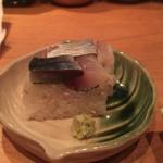 61330379 - お通しは小さな鯖寿司。