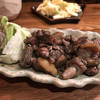 まるしん - 料理写真:かた〜い親鶏のもも焼き 小