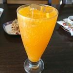 くるくる - ドリンク写真:オレンジスカッシュ(360円)