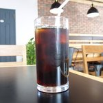 61533026 - スパイシーチキンカレー 1296円 のアイスコーヒー