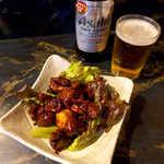 金峰 - 鳥もつ煮(¥550)。運ばれてきた時の香りがご馳走! これは、まさに酒の相棒です