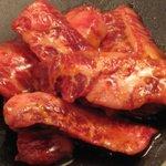 大阪ホルモン - しっかりと味の付いたお肉を炭火で焼いて、だしにくぐらせて食べる!