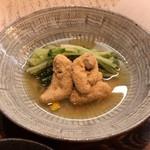 62682315 - たいの子と大阪水菜の炊いたん 780円。出汁の美味しさが非常に際立っており、熱燗ともよく合います。