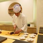 あま木 - 写真撮り忘れの蛸を調理する大将