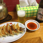 62808244 - 焼き餃子と瓶ビール