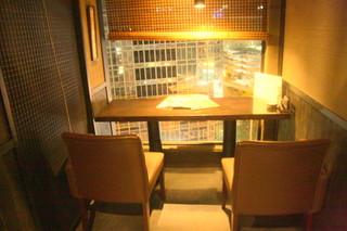 薩摩ごかもん 天満橋総本店 - 2名用カウンター席から眺める夜景