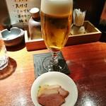 63015651 - グラスビールとお通し