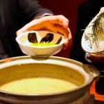 63077890 - 牡蠣鍋の〆、卵&ご飯を投入