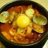 白さんの純豆腐 - 料理写真:豚キムチスンドゥプチゲ+あさり