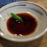 63163628 - 島唐辛子を醤油に溶かし